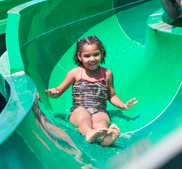 Girl going down water slide at Splash Island